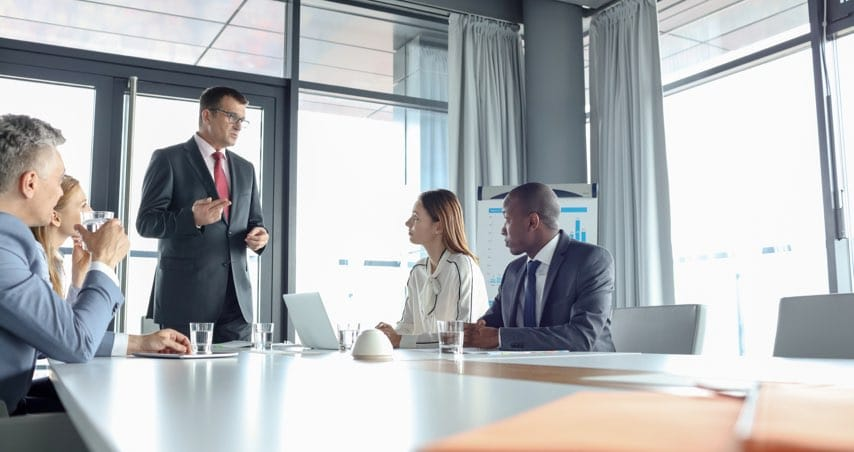 Businessman Discussing with Colleagues in Meeting